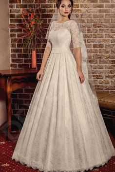 This gorgeous and timeless wedding gown in the classical style is sure to stun everyone.  Its classic cut highlights your slender figure and perfect posture. The lace overlay covering this gown from head to toe is romantic and light, and the flowy skirt is perfect for a twirl. Add an elegant finishing touch and pair this gown with a veil.  Become a bride of unparalleled beauty in this magnificent piece.  *The price doesn't include accessories.