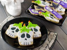 A step-by-step tutorial to make these Halloween Skull Candle Cookies by Semi Sweet Designs
