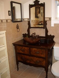 Our bathroom sink my husband made from an antique dresser.