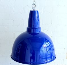 Retro up your home with a large blue pendant light. These make attractive statement lights in a kitchen.