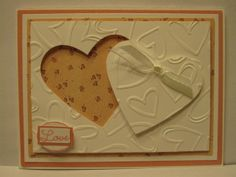 Hand made layered card using Stampin Up Heart Dies, Stampin Up Small Oval, Nestabilities A-2 Matting Basics A, Nestabilities A-2 Matting Basics B, Sizzix Paper and The Paper Studio Heart Embossing Folder