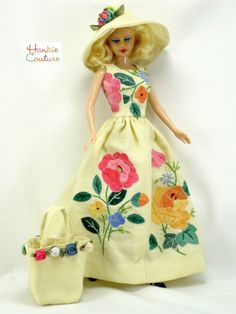 """Linen doll dress with appliqué flowers, sewn from three vintage tea towels!  There are tiny white stitches on each flower and leaf!  Long skirt has center seam. Matching hat has ribbon that matches all the colors in the appliqué. Tote bag has 8 hand-sewn flowers around the top. It fits 11.5"""" Barbie, the custom designed Hankie Couture doll, and similar-sized dolls! By Hankie Couture on eBay in April 2015 #HankieCouture #doll #Barbie #teatowel #appliqué"""