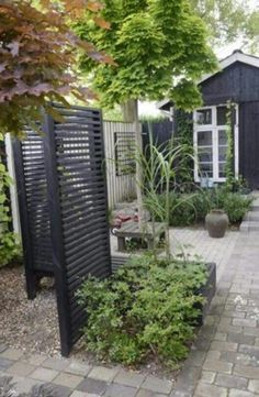 to hide the bins black woodwork in the garden gorgeous against the greenery