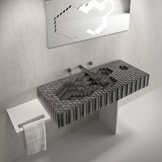 The Giant's Washbasin by Think of Stone is crafted of lava rock and features geometric shapes detailing the inner basin