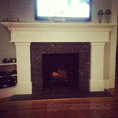Early 1900's home gets a facelift from its original red brick fireplace.  Nothing quite like a real wood burning fireplace! #lostfeature #fireplace #mantle #woodwork #wood #carpentry #design #custom #interiordesign #DIY #reclaimed #upcycle #house #home #jjlv