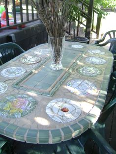 mosaic patio table I made from iron table legs I got at yard sale topped with cement backer board. I broke up plates and tiles to complete then grouted. Mosaic Crafts, Mosaic Projects, Mosaic Art, Mosaic Glass, Mosaic Patio Table, Mosaic Table Tops, Stained Concrete, Stained Glass, Iron Table Legs