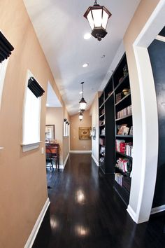 Hallways can offer a nice place for bookcases and small desk nooks for study.  By AAA Homes of MS, LLC