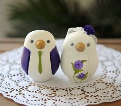 Purple outfit lovebird cake topper