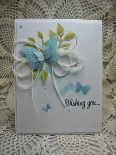 handmade card from created by bjk ... one layer with gorgeous embellishment ...  blue vellum punched butterflies and green vellum leaves ... colored with markers  ... white string tied into a six loop bow ... delicate and sweet