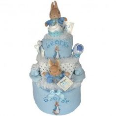 - Proving to be one of our most popular nappy cakes for baby boys, the Peter Rabbit cake contains many essential items needed in the first months of a new baby's life.  This super-deluxe 3 tier nappy cake is not only a great first gift but also a lovely starter kit for the family.