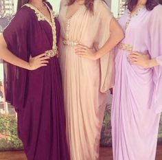 Caftans in different shades of pink and purple. Love this!