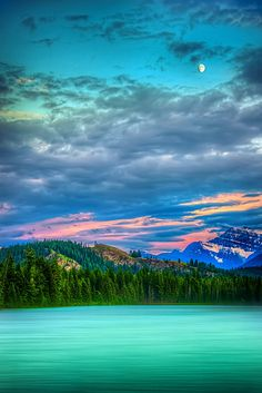 Jasper Dusk, Alberta, Canada. Turquoise lake, vibrant sky and beautiful moon. such a naturally beautiful photo captured at the right time and moment