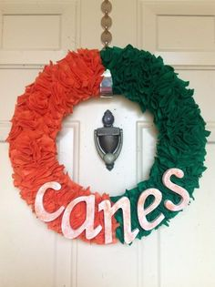 My Miami Hurricanes door wreath. Made with folded felt squares pinned into styrofoam.
