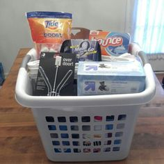 Graduation / College bound gift basket for a male!    Square laundry basket as your base and fill with love!