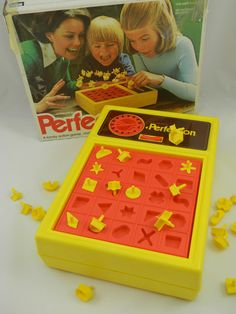 Perfection Game (1975): a game by the Milton Bradley company. The object is to put all the pieces into matching holes on the board (pushed down) before the time limit runs out. When time runs out, the board springs up, causing many, if not all, the pieces to fly out. In the most common version, there are 25 pieces to be placed (the holes form a 5x5 grid) within 60 seconds.