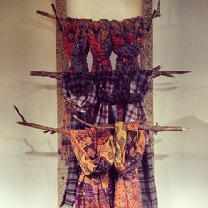 scarf display made with tree branches