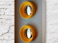 painted brick, yellow mirrors, gray wall