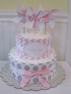 Pinwheel Diaper Cake-Baby Girl Gift by LaurasCraft on Etsy https://www.etsy.com/listing/163496297/pinwheel-diaper-cake-baby-girl-gift