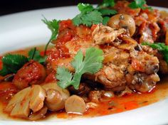 Varna-Style Braised Chicken Bulgarian Dish) Recipe - This is a popular Balkan chicken dish smothered in rich, herby, sherry tomato sauce with mushrooms. Bulgarian Recipes, Bulgarian Food, Macedonian Food, European Cuisine, Braised Chicken, Chicken Seasoning, International Recipes, Food Dishes, Dishes Recipes
