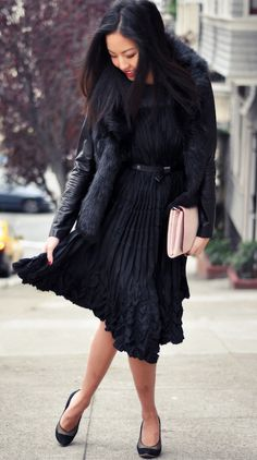 beautiful black dress and coat with a light pink clutch!