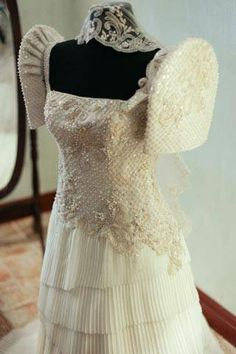 The bridal gown's terno-based ensemble featured an embellished bodice and a dreamy electric pleated skirt that extended to a chapel-length train. Filipiniana Wedding, Filipiniana Dress, Bridal Gowns, Wedding Gowns, Wedding Themes, Wedding Ideas, Electric Pleats Skirt, Diy Gown, Filipino Wedding