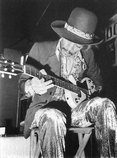 Jimi playing a Gibson Les Paul