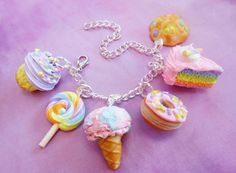Polymer Clay Pastel Sweets Dessert Charm Bracelet Candy Cake Ice Cream Cookies Food Jewelry by ScrumptiousDoodle on Etsy https://www.etsy.com/uk/listing/220609877/polymer-clay-pastel-sweets-dessert-charm