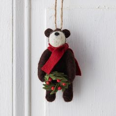 """Made from soft wool felt, this cheerful bear is ready to deck the halls with a wreath of evergreen and berries.- Wool, jute hanging loop- Indoor use only- Hanging loop: 2.5""""L- Imported4.5""""H, 2.5""""W, 2.5""""D"""