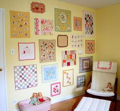 love the wall of mini quilts  doll quilt wall by Hillary Lang, via Flickr