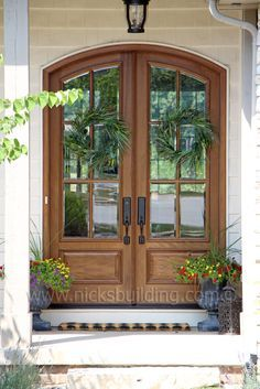 Arched Top French Door. This is not a fiberglass door. This is a True Mahogany Double Door with Glass. bought at www.nicksbuilding.com