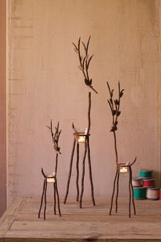 """Light up your home this holiday season with this charming set of three rustic iron reindeer! Each comes with a glass tealight holder. Candles not included. large: 4½"""" x 7½"""" x 36""""t medium: 3"""" x 6"""" x 27""""t small: 2½"""" x 5"""" x 19½""""t"""