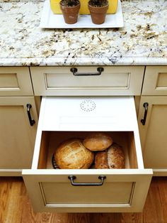 Fresh Bread An old-fashioned bread drawer with a ventilated lid keeps loaves fresh and provides a convenient storage spot. If you don't have cabinet storage space for a bread drawer, consider a retro-inspired breadbox. The box still keeps bread bakery-fresh, but doesn't take up valuable kitchen cabinet space.