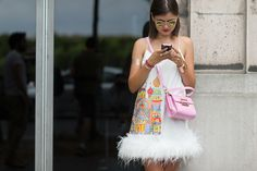 In love with this look! The colorful print on the side, the feathers, that #pink bag!  [The Best Street Style From Couture  - ELLE.com] #fashion #fabulous