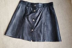 Vintage 70s black leather mini skirt size small-medium  Made in Italy. by…