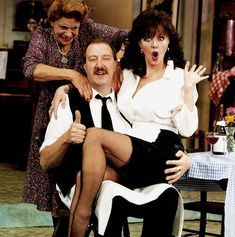 Allo Allo comedy series about the french resistance starring Gordon Kaye actor as cafe owner Rene Carmen Silvera actress as his wife and Vicki Michelle actress as waitress Yvette sitting on his knee British Comedy Films, British Tv Comedies, Comedy Tv, British Actors, Vicki Michelle, Jennifer Aniston Legs, Uk Tv Shows, Cinema Movies, Vintage Tv