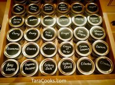 36 Ball jars filled with spices, labeled with Chalky Talky peel and stick labels, stored alphabetically left to right, front to back.