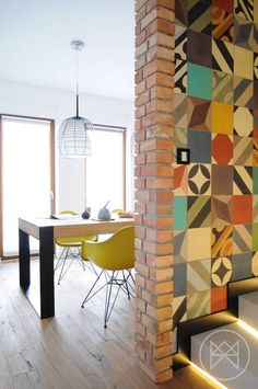 Polish design firm Widawscy Studio Architektury have created a home full of colour and pattern