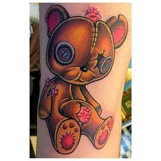 cool torn up teddy bear tattoo