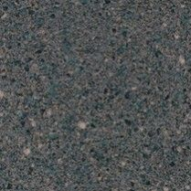 Smoky Topaz - 4589K-07 A charcoal grey small scale quartz/engineered stone design accented with light taupe, black and blue-green chips.