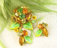 Beautiful greens oranges and yellow art glass brooch and earring set.