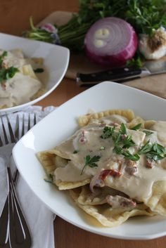 Mushroom Ravioli with Garlic Sun-dried Tomato Cream.