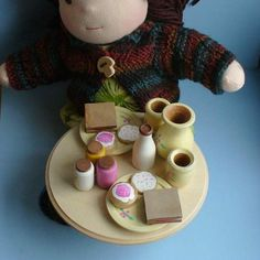 Wooden Toy Waldorf Doll Tea Party / by TheEnchantedCupboard, $36.00  I love the colors and details in this tea set for kids