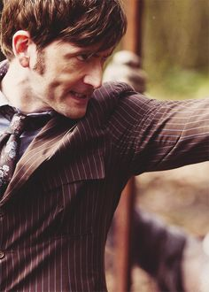 David Tennant as Ten in the 50th. I JUST NOTICED HIS TIE HAS ROSES ON IT AHHHHHH! THERE ARE NO COINCIDENCES!