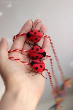 Set of three Martenitsa bracelet with small Needle Felt Ladybug. Colors: Red and White, Black and Colorful Ends. *If you prefer it in a different color or merely wish to order more/less of them you may contact me.   History:  Martenitsa (Bulgarian: мартеница,) is a small piece of