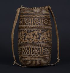 Ajat basket, Penan people. Borneo 20th century, 15 (cm) diameter by 30 (cm) height. Hornbill motif.