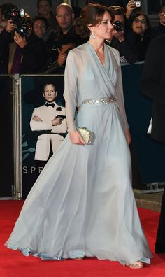 Princess Kate hit the red carpet wearing an ethereal chiffon Jenny Packham gown that featured sheer draped sleeves, a semi-open back, plunging neckline, and sparkling belt. She topped of her look with an assortment of dazzling accessories.