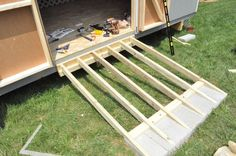 to Build a Shed Ramp Building a shed ramp. Watch thousands of spinal cord injury videos at Building a shed ramp. Watch thousands of spinal cord injury videos at Backyard Sheds, Outdoor Sheds, Outdoor Gardens, Concrete Sheds, Shed Ramp, Shed Construction, Construction Estimator, Cheap Sheds, Shed Organization