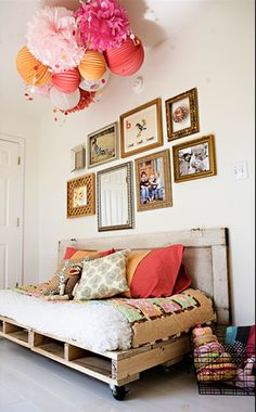 reading bed w/ frame made from wood pallets  Patio. Pallets and door back or plywood probably