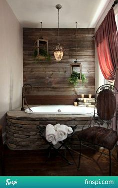 Rustic bathroom design with raw wood wall, stone tub, & drop lighting Stone Tub, Wood Stone, Rustic Stone, Rustic Wood, Rustic Feel, Rustic Modern, Rustic Farmhouse, Rustic Cottage, Weathered Wood