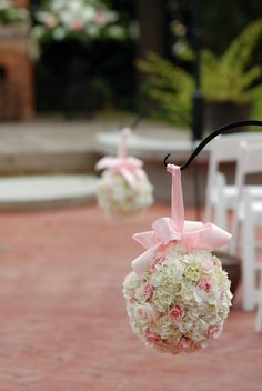 To hang from shepard's hooks and put along driveway; brighter pink flowers/ribbon